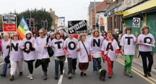 'Welfare not warfare': Protesters march on NATO Summit