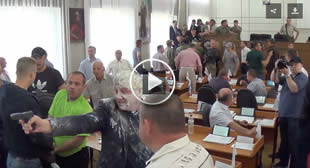 Wild West Ukraine: Thugs pour milk on politician at council meeting, he draws his gun (VIDEO)