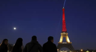 Eiffel Tower Lights Up in Colors of Belgium's Flag