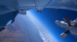 Russian Su-30 Jet Pulls Up to Il-76 Transport in Midair, Peeks Inside Open Hatch