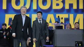 Weary Ukrainian voters face ultimate choice between comedian & politician